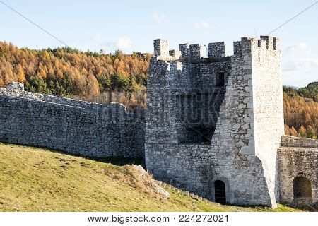 The square stone tower of a medieval castle