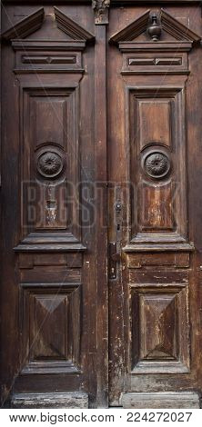 The vintage brown  wooden front door of an old house