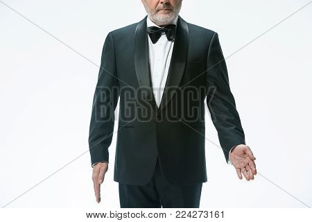 The senior waiter holding white towel and standing isolated on white studio background. sign language in the restaurant. Gesture means - Take this place away