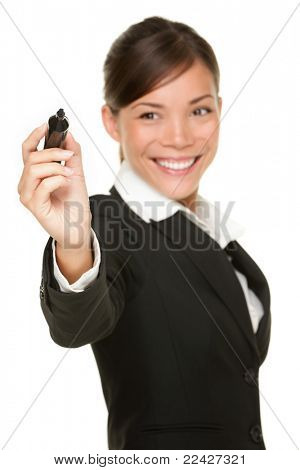 Business woman writing with black marker pen on virtual screen. Young professional smiling wearing suit. Chinese Asian / Caucasian businesswoman isolated on white background.