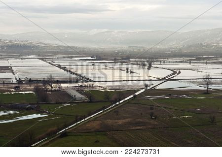 Type of flooded fields, agricultural sites. View from a height. Mountainous terrain. Greece
