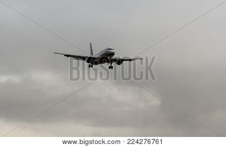 St. Petersburg, Russia - 21 June, The plane with the released chassis comes on landing, 21 June, 2016. Takeoff and landing of aircraft at the airport in St. Petersburg, Pulkovo.