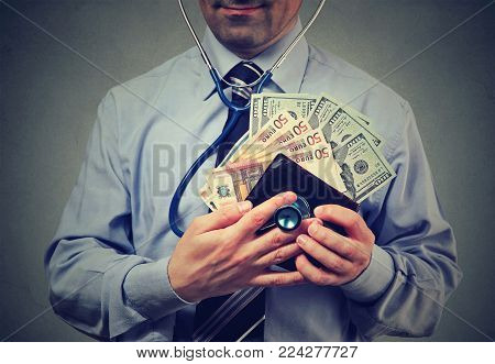 Man with euro and dollar cash in his wallet