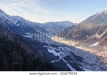 The Mont Blanc and the Valley near Chamonix de Mont Blanc, as seen from the Cable Car to the Aiguille du Midi