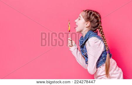 Cute teen girl with candy lollipop