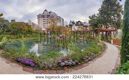 SOCHI, RUSSIA - NOVEMBER 20, 2017: Panorama of the New Square with a pond
