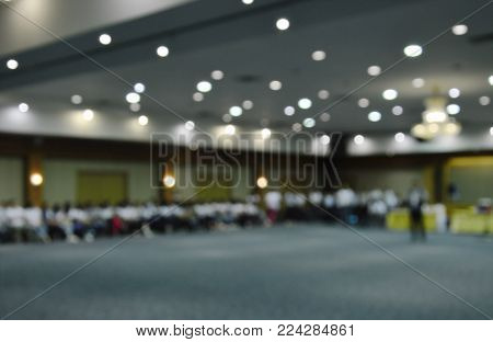 blur of people meeting in conference room