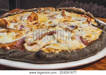 Hot delicious pizza freshly cooked in a cafe