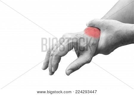 Man holds his hand acute pain in a wrist