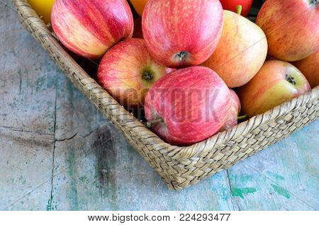 Organic red Apples on a wooden table