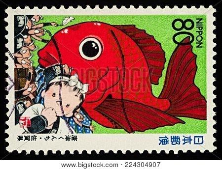 Moscow, Russia - January 30, 2018: A stamp printed in Japan shows Japanese Karatsu Kunshi festival in the city of Karatsu, series