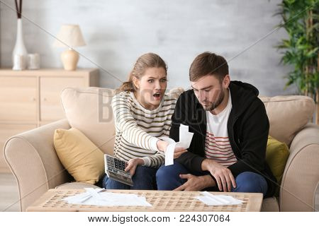 Couple arguing about money at home. Problems in relationship