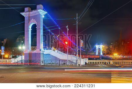 SOCHI, RUSSIA - JANUARY 28, 2018: Arch of a suspension bridge across the Sochi River