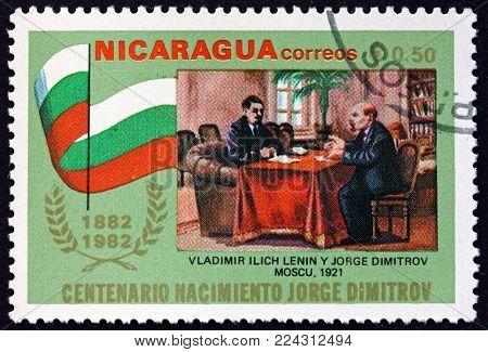 NICARAGUA - CIRCA 1982: a stamp printed in Nicaragua shows Lenin and Dimitrov, 1921, circa 1982