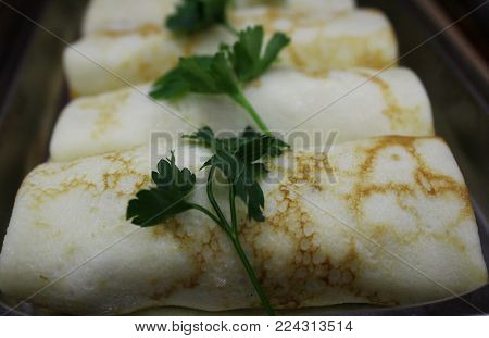 Pancakes seasoned with fresh herbs. The baked delicacy.