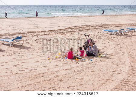 Benidorm, Spain - January 14, 2018: Family enjoying holiday in popular spanish resort Benidorm, Costa Blanca, Spain.
