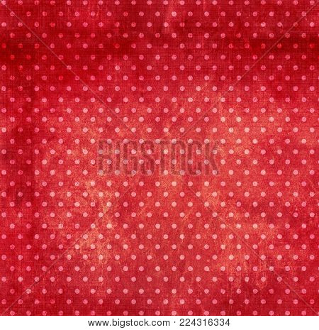 Grunge background with dots pattern and paper texture of red color. Backdrop can be used for wallpaper, pattern fills, web page background, surface textures, vintage and retro desing