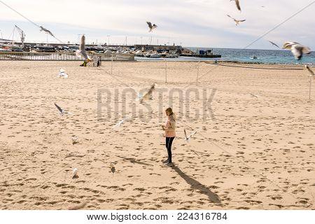 Benidorm, Spain - January 14, 2018: Woman relaxing in Benidorm beach, Spain in Winter time