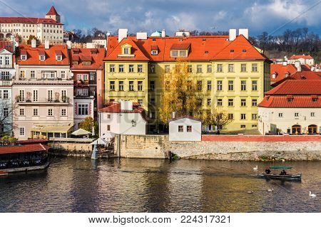 Vltava river and the building of the Museum of Franz Kafka in Prague, Czech Republic.