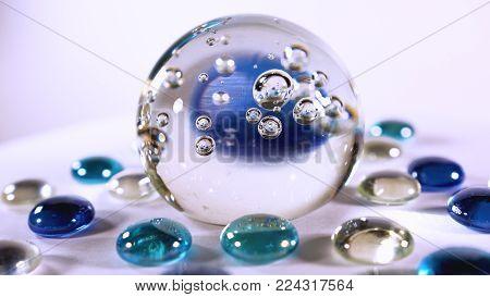 a magic ball for divination. blue glass ball close-up.