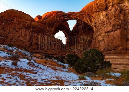Gorgeous sunset shot of Double Arch at Arches National Park during the winter in Moab Utah USA.