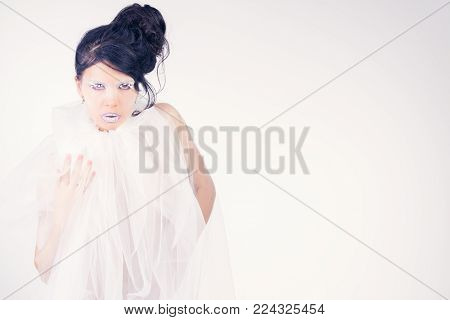 young beautiful sensual woman posing in tulle with beauty makeup
