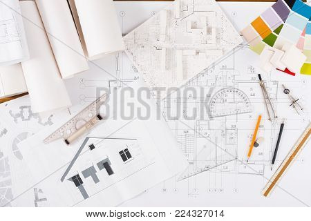 Workplace of architect. Engineering tools for creating new architectural project on table, top view