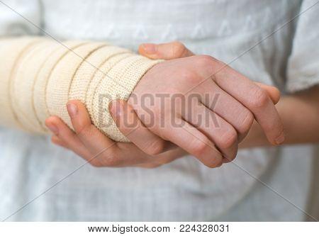Child arm with elastic bandage on it.