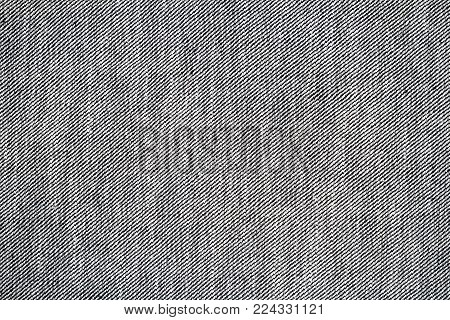 Wrong side of black jeans fabric. Jeans inside texture background