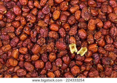 Closeup of dried pitted Chinese date, also called Jujube, red Date with one cut in half showing inner texture (Ziziphus jujuba)