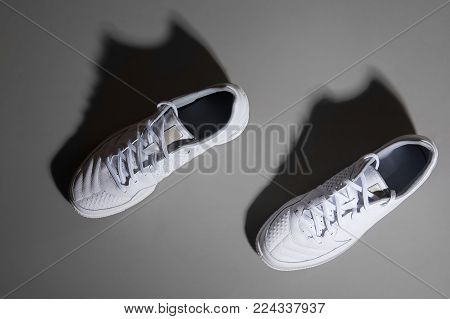 White running shoes on the gray floor