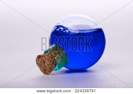 blue liquid in old style vial. close up