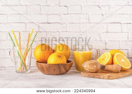 Oranges and juicer for making orange juice. Copy space.