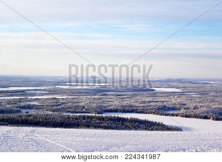 Panoramic view from top of mountain in winter landscape. Winter forest landscape.
