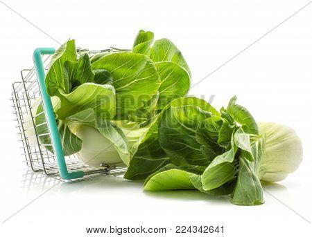 Bok choy (Pak choi) out a shopping basket isolated on white background fresh raw
