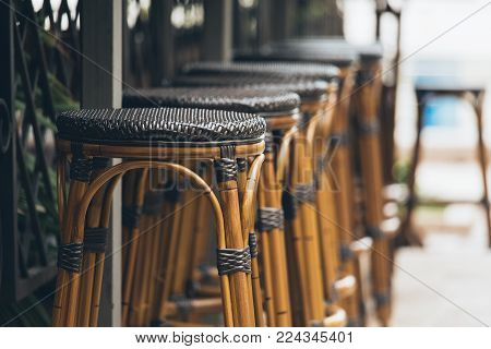 Wooden bar stools in a row. Street restaurant