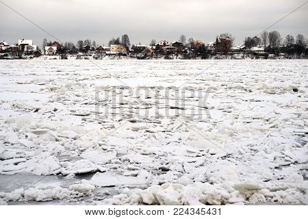 Frozen Neva River on the outskirts of St. Petersburg at cloud winter day, Russia.