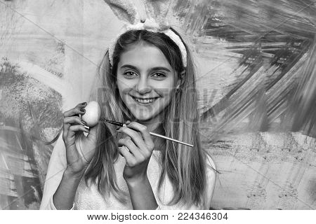 Happy Easter Girl In Bunny Ears With Egg And Paintbrush