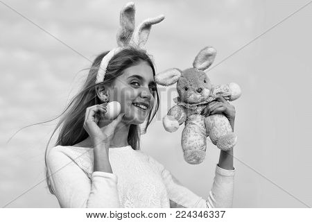 Happy Easter Girl With Bunny Ears, Egg On Blue Sky