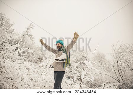 Bearded Man With Skates In Snowy Forest. Man In Thermal Jacket, Beard Warm In Winter. Winter Sport A