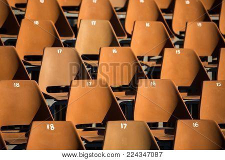 Row of plastic seats in the stadium tribune
