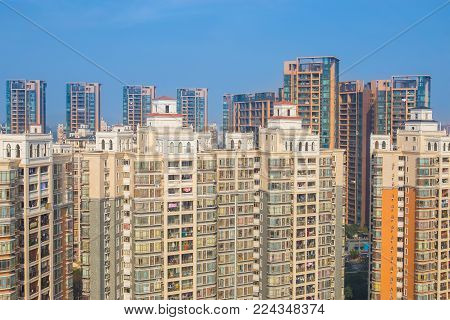 Suzhou, China - March, 3,2015: Modern high-rise apartments located alongside a canal. Image captured from tour shuttle bus