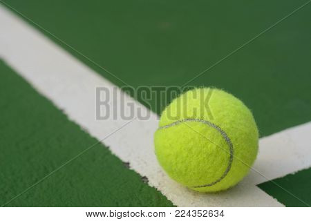 Tennis ball on tennis courts and abstract background