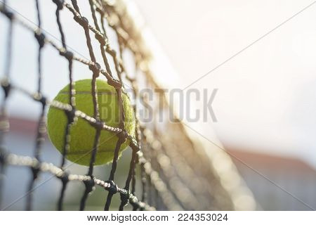 Close Up Tennis Ball Hitting To Net