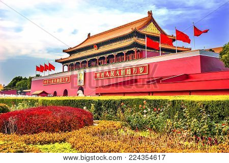 BEIJING, CHINA - NOVEMBER 13, 2017 Mao Tse Tung Tiananmen Gate Gugong Forbidden City Palace Wall Beijing China.  Chinese Sayings on Gate Are