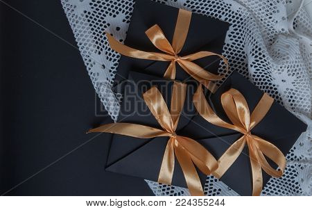 gift black opening, wrapped with a golden ribbon, top view