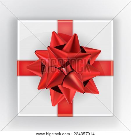 White Gift Box With A Red Bow And Shadow. Curve Red Ribbon With A Gold Stripe Tied Bow Isolated Real