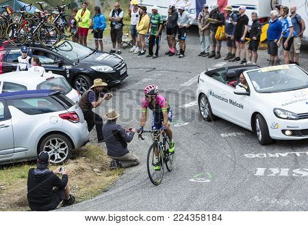 Col du Glandon, France - July 24, 2015: The Portuguese cyclist Nelson Oliveira of Lampre-Merida Team,climbing the road to Col du Glandon in Alps, during the stage 19 of Le Tour de France 2015.