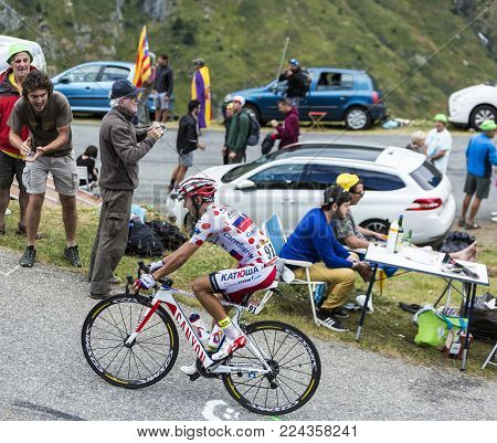 Col du Glandon, France - July 24, 2015: The Spanish cyclist Joaquim Rodriguez of Katusha Team,climbing the road to Col du Glandon in Alps, during the stage 19 of Le Tour de France 2015.