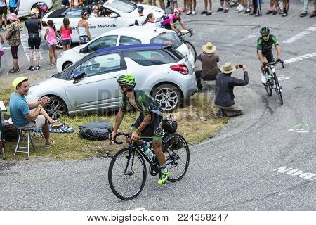 Col du Glandon, France - July 24, 2015: The French cyclist Bryan Coquard of Europcar Team,climbing the road to Col du Glandon in Alps, during the stage 19 of Le Tour de France 2015.